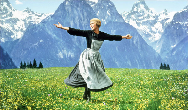 Julie Andrews in a meadow being super happy before the Nazi's ruin everything for her.